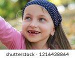 portrait of toothless child... | Shutterstock . vector #1216438864