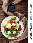 fresh healthy salad witn... | Shutterstock . vector #1216443601