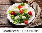 fresh healthy salad witn... | Shutterstock . vector #1216443604