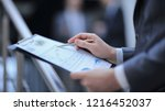close up. businessman checking... | Shutterstock . vector #1216452037