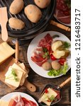 raclette cheese with meat and... | Shutterstock . vector #1216483717