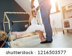 daughter standing on feet of... | Shutterstock . vector #1216503577