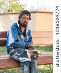 homeless man on the street of... | Shutterstock . vector #1216504774
