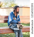 homeless man on the street of... | Shutterstock . vector #1216522201