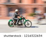 biker riding motorcycle at... | Shutterstock . vector #1216522654