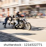 bikers riding motorcycle at... | Shutterstock . vector #1216522771