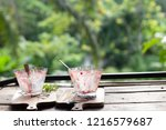 ice cream in the empty glass on ... | Shutterstock . vector #1216579687