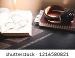 selective focus glasses on book ... | Shutterstock . vector #1216580821