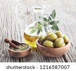 oilve oil with oregano on... | Shutterstock . vector #1216587007