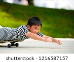 little asian boy lying on a...   Shutterstock . vector #1216587157