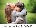 happy little girlfriends in park   Shutterstock . vector #121663495