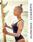 beautiful girl surfer with a... | Shutterstock . vector #1216636951