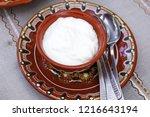 yoghurt in traditional ceramic... | Shutterstock . vector #1216643194
