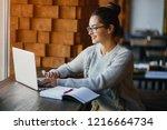 brunetter woman working on her... | Shutterstock . vector #1216664734