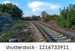 lonely railway at the village | Shutterstock . vector #1216733911