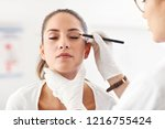 plastic surgeon making marks on ... | Shutterstock . vector #1216755424