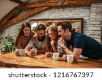 group of friends using... | Shutterstock . vector #1216767397