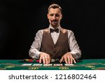 portrait of a croupier is... | Shutterstock . vector #1216802464