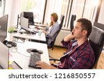 two business colleagues sitting ... | Shutterstock . vector #1216850557