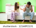 woman and man in the bedroom... | Shutterstock . vector #1216892131