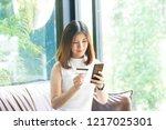 young beautiful asian woman... | Shutterstock . vector #1217025301