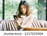 young beautiful asian woman... | Shutterstock . vector #1217025304