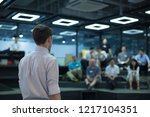 back of speaker giving lecture... | Shutterstock . vector #1217104351