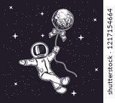 the astronaut flies in space.... | Shutterstock .eps vector #1217154664