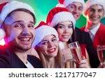 group of happy friends in santa ... | Shutterstock . vector #1217177047