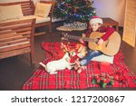 girl with a dog playing the... | Shutterstock . vector #1217200867