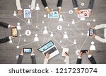 group of people with devices in ... | Shutterstock . vector #1217237074