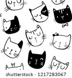 Stock vector seamless vector pattern with cats smiling cute cats background doodle hand drawn style 1217283067