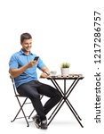 young man sitting at a coffee... | Shutterstock . vector #1217286757