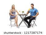young man and woman sitting at... | Shutterstock . vector #1217287174