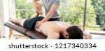 physical therapist giving... | Shutterstock . vector #1217340334