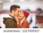 young couple walking outside...   Shutterstock . vector #1217435317