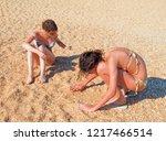 family having fun on the beach... | Shutterstock . vector #1217466514