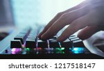 male hands typing on a laptop... | Shutterstock . vector #1217518147