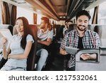 young smiling people traveling... | Shutterstock . vector #1217532061