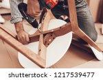 assemble furniture. man... | Shutterstock . vector #1217539477