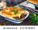 steak and mushroom pie on... | Shutterstock . vector #1217628301