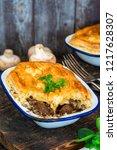 steak and mushroom pie on...   Shutterstock . vector #1217628307