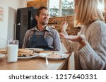 husband and wife having... | Shutterstock . vector #1217640331