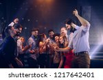 Stock photo group of friends having fun in the club 1217642401