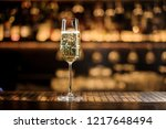 glass of champagne standing on... | Shutterstock . vector #1217648494