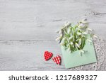 snowdrops in an envelope and... | Shutterstock . vector #1217689327