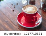 red coffee cup put on an old...   Shutterstock . vector #1217710831