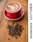 red coffee cup put on an old...   Shutterstock . vector #1217710834