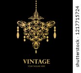 golden chandelier logo on black ... | Shutterstock .eps vector #1217715724