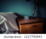 night stand with watch  | Shutterstock . vector #1217790991
